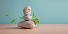 Enjoying Life, Harmony And Positive Mind Concept. Stack Of Stable Pebble Stone With Smiling Face Cartoon And Leaf. Serene, Balancing Body, Mind, Soul And Spirit. Mental Health Practice