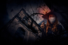 Halloween Witch Wearing Medical Face Mask Holding Magic Wand Standing Over Grunge Castle, Dead Tree, Bird Fly, Full Moon And Cloudy Spooky Sky, Halloween And Coronavirus Or Covid-19 Concept