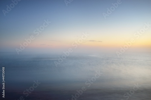 Fototapeta Breathtaking panoramic aerial view of the sea in a clouds of thick white fog