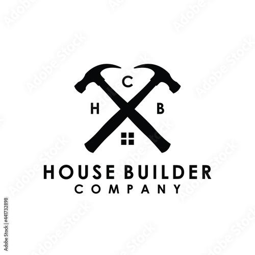 Fotografie, Obraz crossed hammer house builder construction renovation logo design vector
