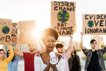 Demonstrators Group Protesting Against Plastic Pollution And Climate Change - Multiracial People Fighting On Road Holding Banners On Environments Disasters - Global Warming Concept