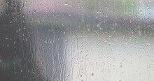 Streams Of Raindrops On Window Glass