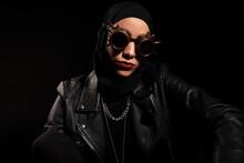 Fashionable Muslim Woman In Creative Sunglasses In Studio