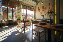 Interior Of Modern Cafe With Wooden Furniture