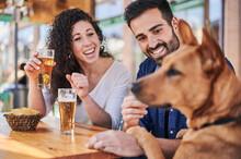 Smiling Ethnic Couple With Beer Spending Weekend In Restaurant