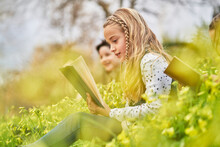 Company Of Kids Reading Books In Park