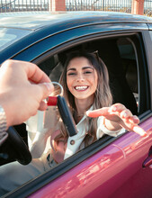 Happy Buyer In New Car Receiving Ignition Key In Town