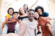 Multicultural Happy Friends Having Fun Taking Group Selfie Portrait On City Street - Young Diverse People Celebrating Laughing Together Outdoors - Happy Lifestyle Concept