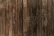 Drewniane brązowe tło, tekstura desek.