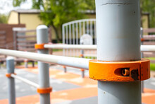 Close-up Of Yellow Metal Railing Against Blurred Background
