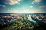 Fototapeta Kawa jest smaczna - High Angle View Of Townscape By River Against Sky