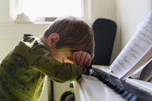 Sad Boy (6-7) Leaning On Piano