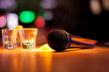 Close-up Of Microphone With Drink Shots