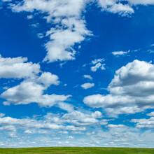 USA, Idaho, Bellevue, Fluffy Clouds On Sky Above Field Near Sun Valley