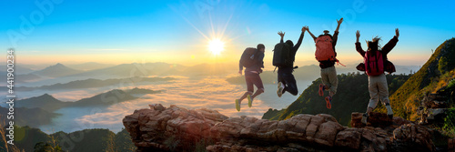 Canvas Print Group of happy hiker jumping on the hill