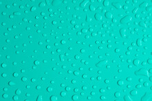 Water Drop Pattern On Turquoise Background.