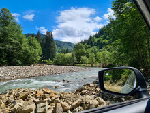 View From Car Window At River Creek In Mountains