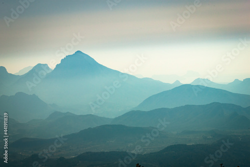 Stampa su Tela Scenic View Of Mountains Against Hazy Sky