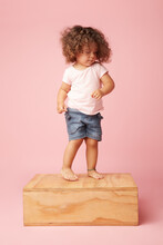 Cute Toddler Girl In Casual Wear On Pink Background