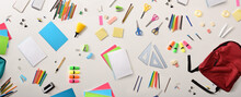 Assortment Of School Supplies On White Table Top View