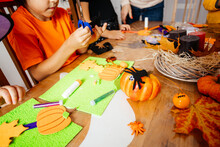 Preparing Traditional Halloween Decorations With Young Children