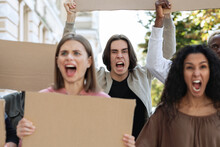 Closeup Of Furious Multiracial Protestors With Empty Placards