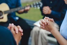 Christian Families Worship God In The Garden By Playing Guitar And Holding A Holy Bible. Group Christianity People Reading The Bible Together.Concept Of Wisdom, Religion, Reading, Imagination.