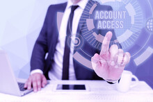 Handwriting Text Account Access. Business Concept Full Privilege For The Owners To Manage Their An Individualal Data Bussiness Man Sitting Desk Laptop And Phone Pointing Futuristic Technology.