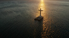 Catholic Cross In Sunken Cemetery In The Sea At Sunset, Aerial View. Sunset At Sunken Cemetery Camiguin Island Philippines.