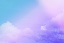Beauty Abstract Sweet Pastel Soft Blue Purple With Fluffy Clouds On Sky. Multi Color Rainbow Image. Fantasy Growing Light