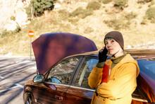 Woman Having Phone Call After Car Breakdown