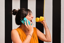 Funny Woman With Smartphone And Retro Telephone Receiver