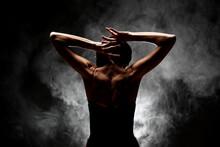 Half Silhouette Modern Ballet Dancer Posing On Dark Background With Smoke
