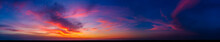 Dramatic Wide Panorama Of Late Sunset With Burning Sky