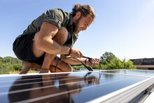 Man Connecting A Solar Panel