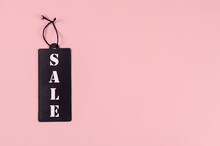 Black Tag Sale On A Pink Background. Paper Rectangular Tag With