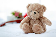 Brown Lovely Fluffy Teddy Bear Toy Sitting On Bed Near Guitar As Lovely Doll For Enjoy Music Playing On Delight Celebration Holiday.