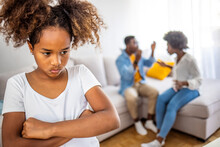 Frustrated Girl Tired Of Parents Fights, Child And Divorce Concept. Upset Frustrated Little Girl Tired Of Parent Fight, Toddler Daughter Holding Toy Dreaming That Family Conflicts Would Stop