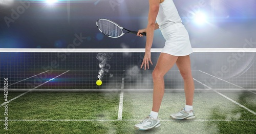 Composition of female tennis player holding tennis racket at tennis court
