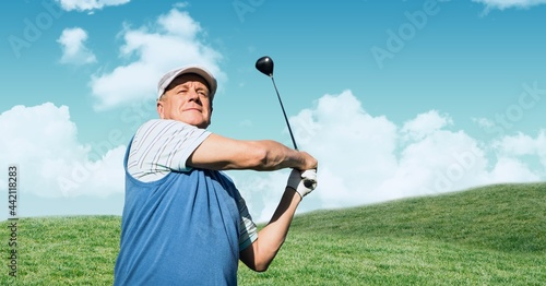 Composition of senior male golf player playing golf outdoors