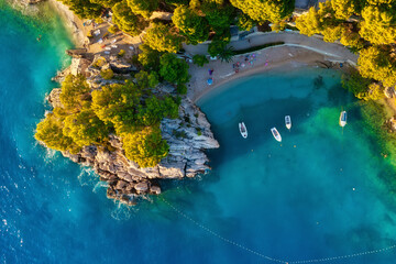 Mediterranean sea. Aerial view on the beach and people. Beach and blue water. Top view from drone at beach and azure sea. Travel and vacation image