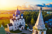 Aerial Drone View Of Suzdal Kremlin And Cathedral Of Nativity At The Kamenka River, Russia. Summer Sunny Day Sunset