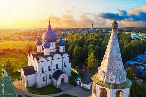Fototapeta Aerial drone view of Suzdal Kremlin and cathedral of Nativity at the Kamenka river, Russia
