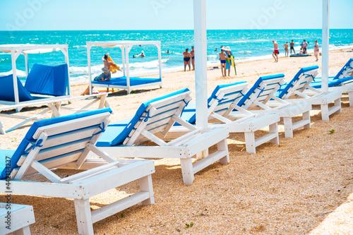 Fotografia, Obraz Sun loungers on the beach near the blue sea