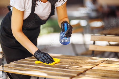 Fotografering Disinfection of a cafe, restaurant, coffee shop before opening