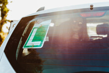 Woman Sticking Low Gear Sign On Rear Windshield