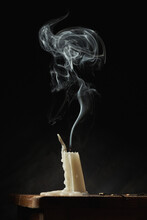 Extinguished Candle On Black Background