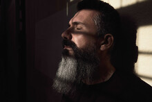 Tranquil Bearded Man In Room With Sunlight