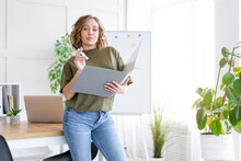 Businesswoman Holding Folder For Paper Write Marker Thinking Dreaming Standing Near Office Table