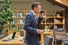 Designer Sitting On His Desk Having A Coffee